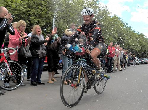 Mike Hall crosses the line in Greenwich after smashing the round-the-world record