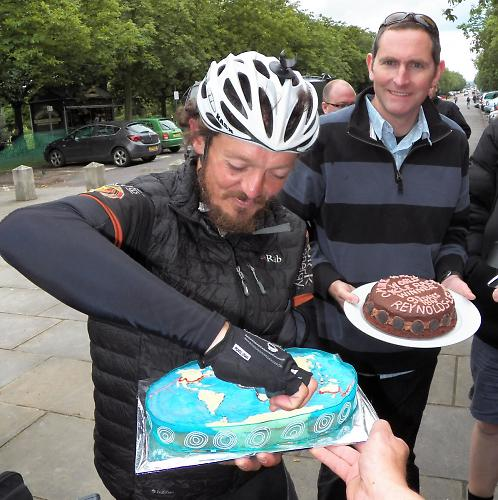 """""""Shall I cut a Meridian?"""" Mike and a cake iced with his route."""