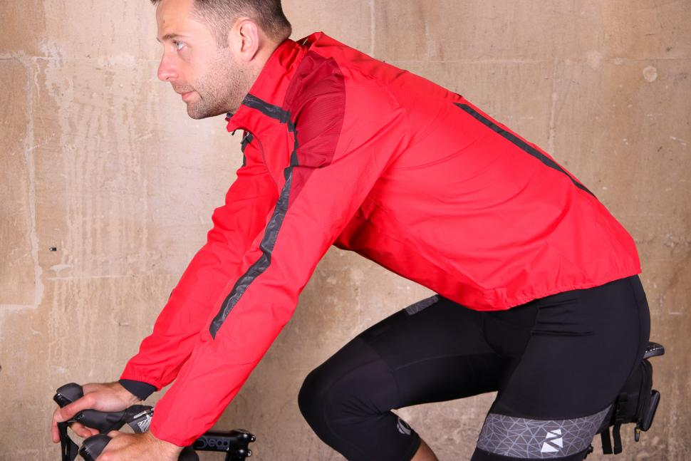 Altura Nightvision Waterproof Jacket Team Red - riding.jpg
