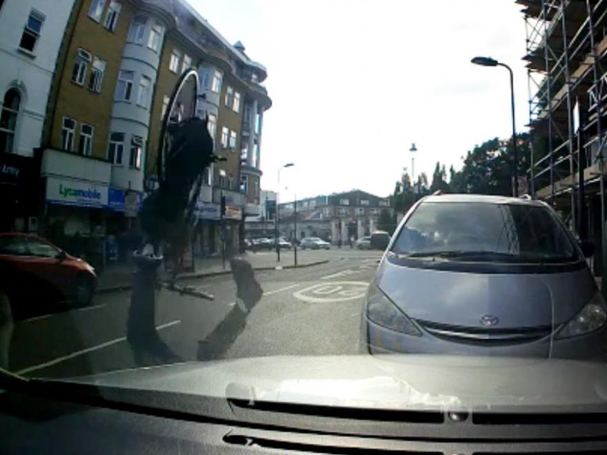 Cyclist somersaults after hitting pothole (still taken from London Evening Standard video).jpg