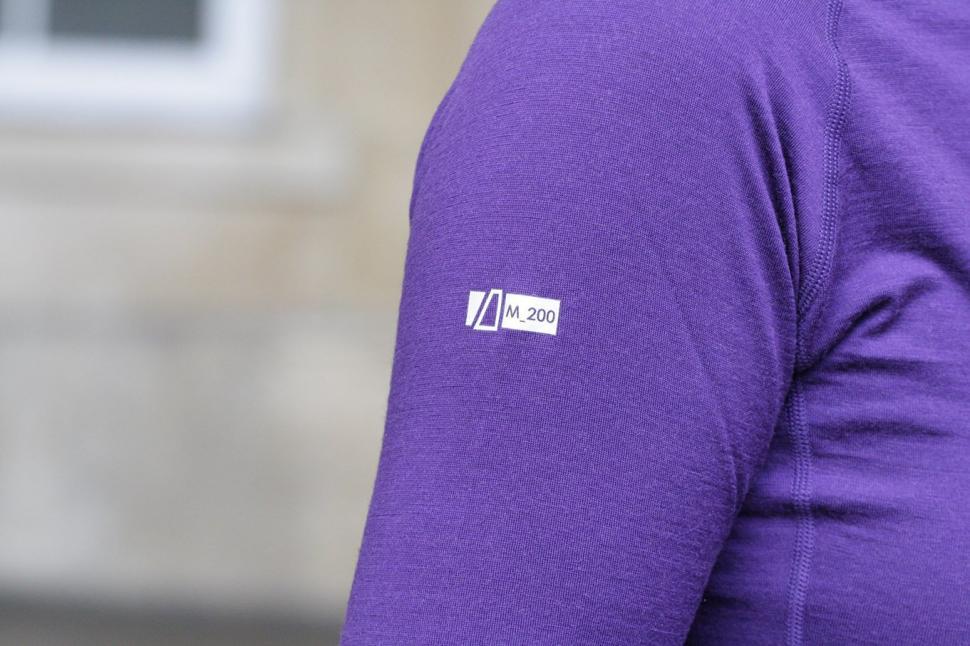 dhb Womens Merino LS Zip Neck Base Layer - sleeve logo.jpg