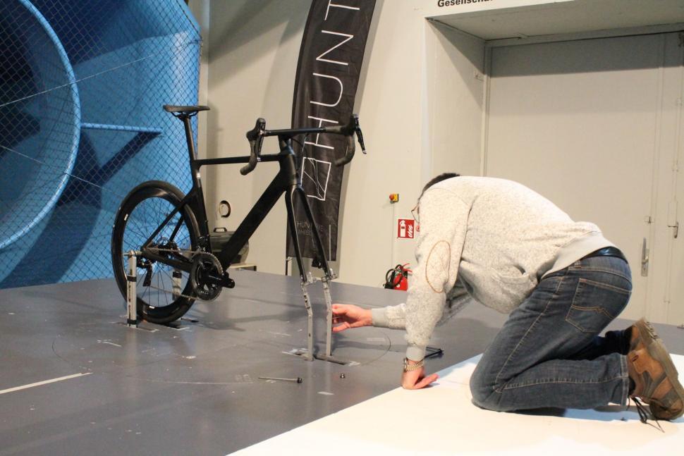 Hunt - Ernst setting up bike - 1.jpg