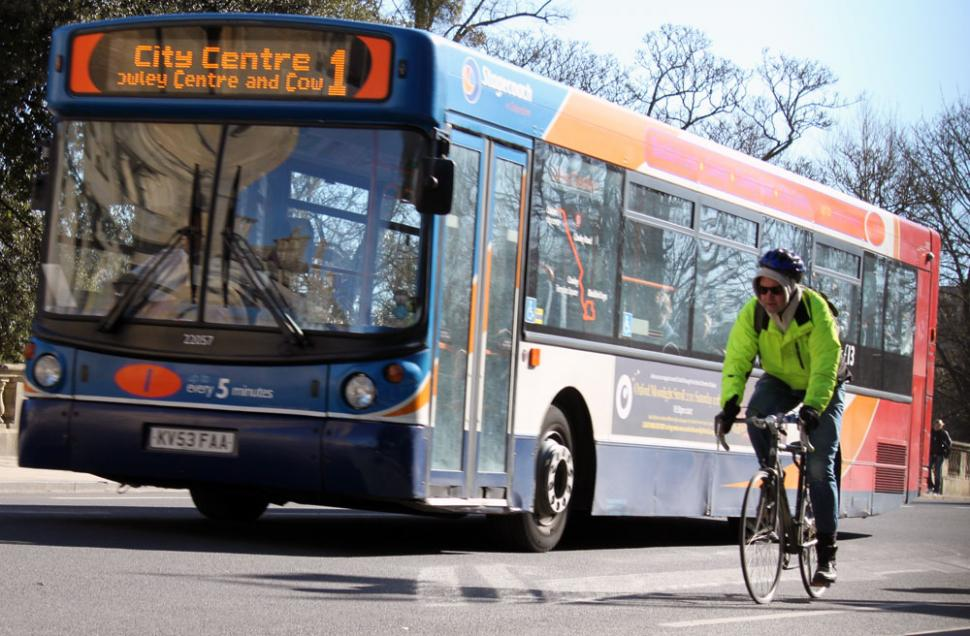Bike and bus in Oxford (CC licensed image by tejvanphotos:Flickr)