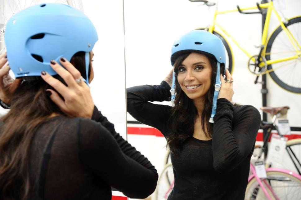 Christine Bleakley trying on a cycle helmet (picture courtesy Barclays)