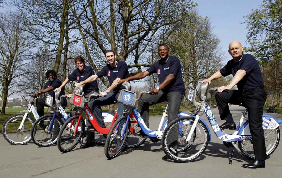 Martin Keown (centre) on a red Boris bike