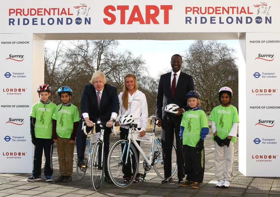 Prudential RideLondon launch, Boris Johnson, Laura Trott and Tidjane Thiam with schoolchildren