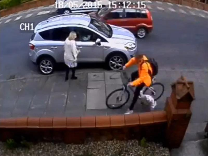 Still from CCTV footage of cyclist hitting toddler