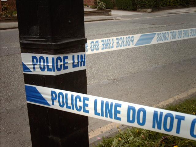police line (CC licensed by hugovk_Flickr)