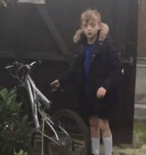 James Brewster gets his bike back (picture credit - Facebook video still by Una Magee Brewster).PNG