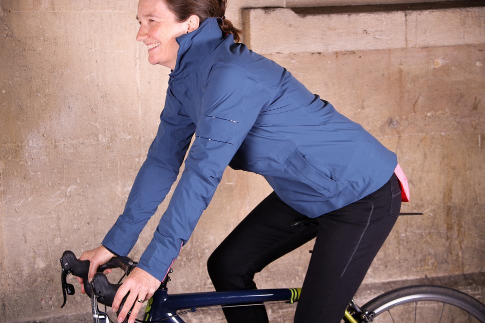Rapha Womens Hooded Rain Jacket - riding.jpg
