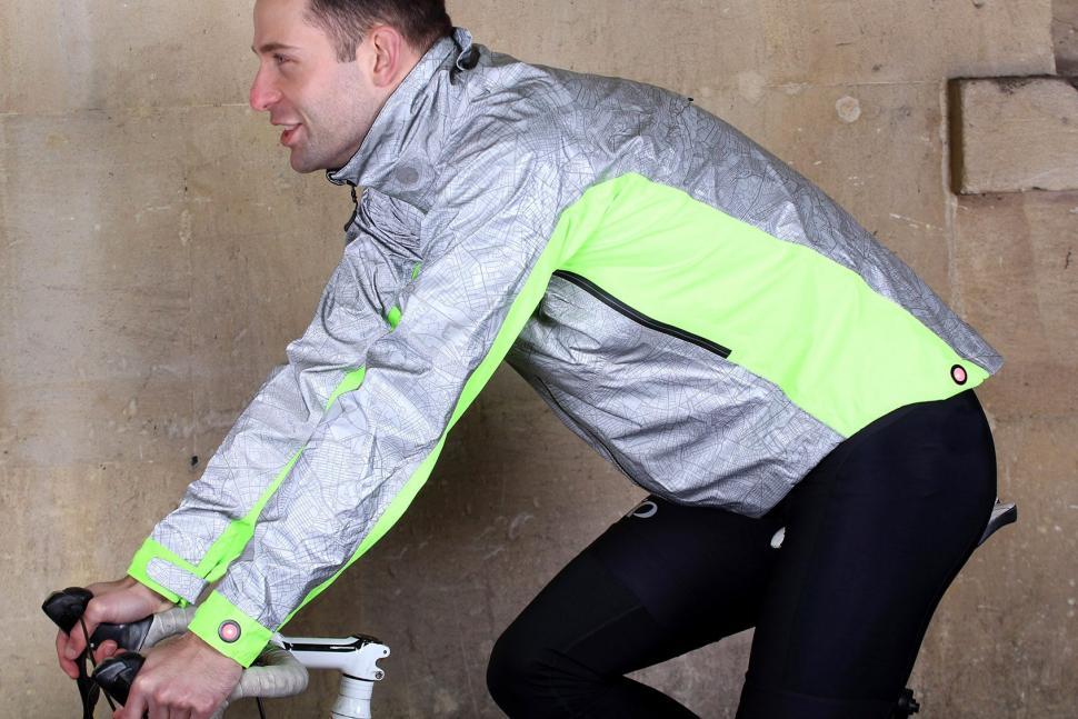 Showers Pass Mens Hi Vis Torch Jacket - riding.jpg