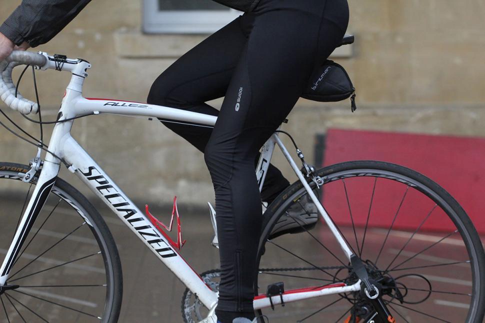 Sugoi Windblock Bib Tight - riding.jpg