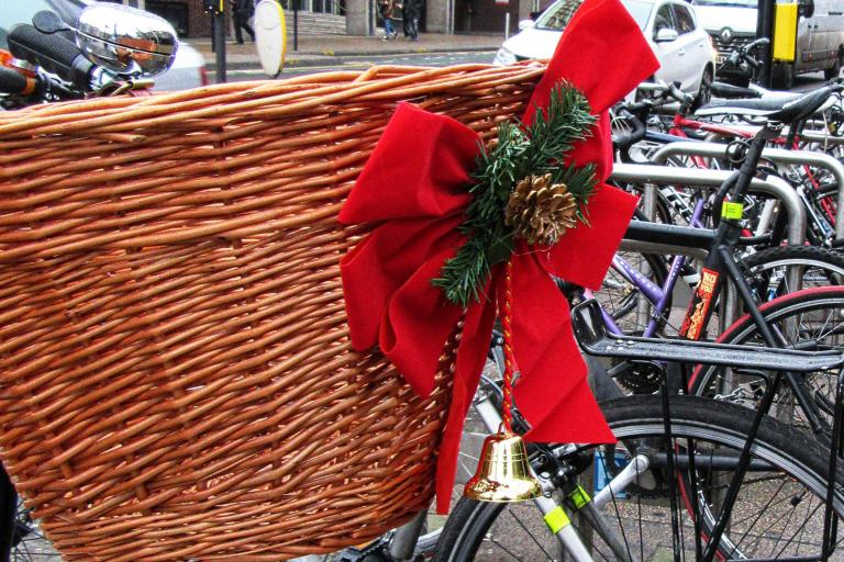 Bike Basket and Christmas Bow (licensed CC BY 2.0 on Flickr by Dun.can).jpg