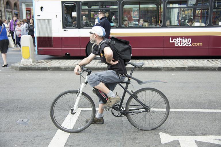 Cyclist in Edinburgh (licensed CC BY-2.0 by Mark Morgan on Flickr).jpg