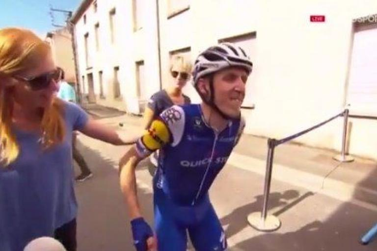 Dan Martin getting off his bike (via YouTube).jpg