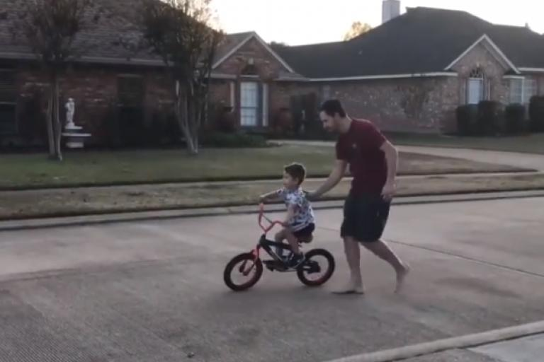 FAther teaching kid to ride - soiurce Reddit.PNG