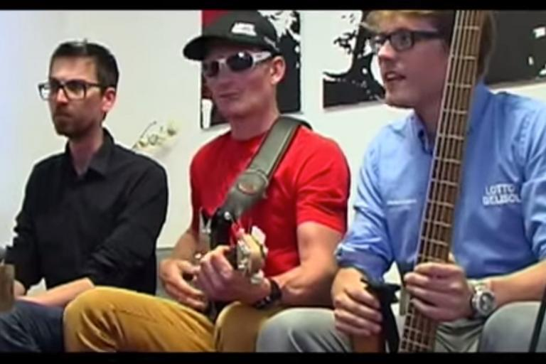 Andre Greipel playing the guitar - he sings too, apparently (image via Lotto Belisol YouTube channel)