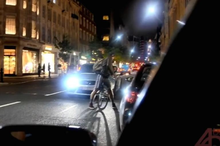 Cyclist and Mercedes.png