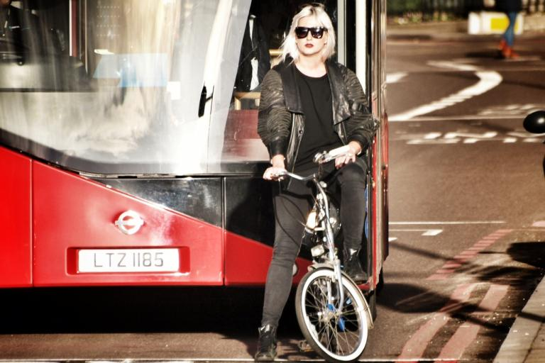 Cyclist and bus in London (copyright Simon MacMichael)