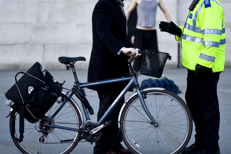 Cyclist and policeman (CC licensed image by stumayhew:Flickr)