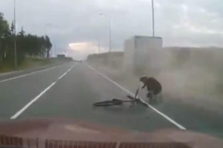 Cyclist in Russia gets up after being run over by truck YouTube still