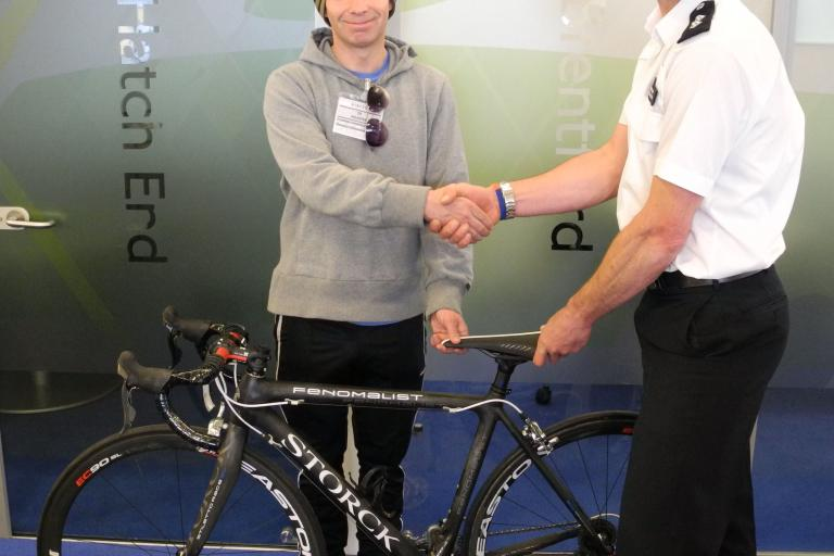 Cycle Task Force Inspector Peter Salter reunites Steve Jensen with the stolen bike