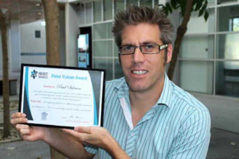 Dr Salmon alongside his award (image from usc.edu.au)