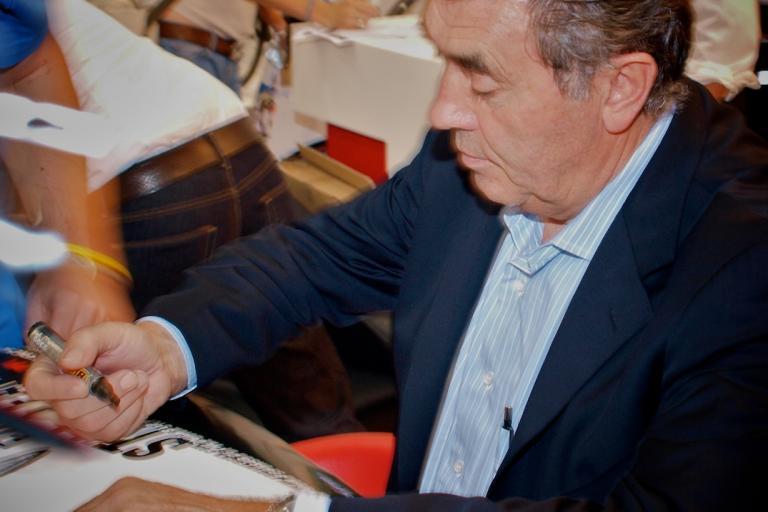 Eddy Merckx signing autographs