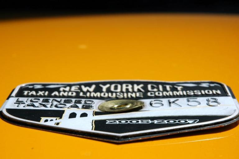 NYC taxicab medallion (CC licensed by Danielle Lupkin, Wikimedia Commons)