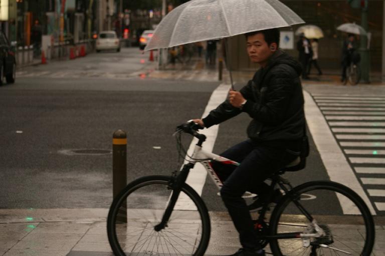 Osaka cyclist in rain (CC licensed by Akuppa John Wigham via Flickr)