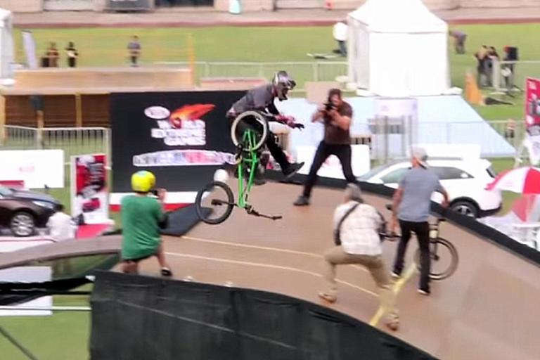 Pat Laughlin reaches for his second bike after ditching the first
