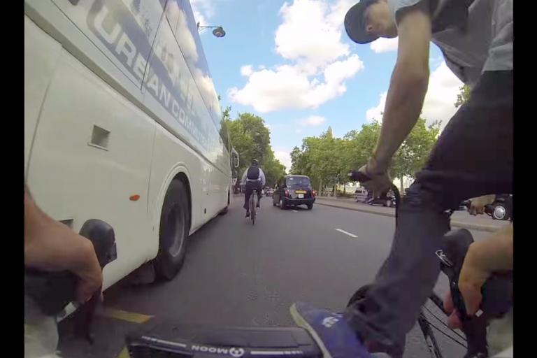 Rider on BMX kicks cyclist off bike