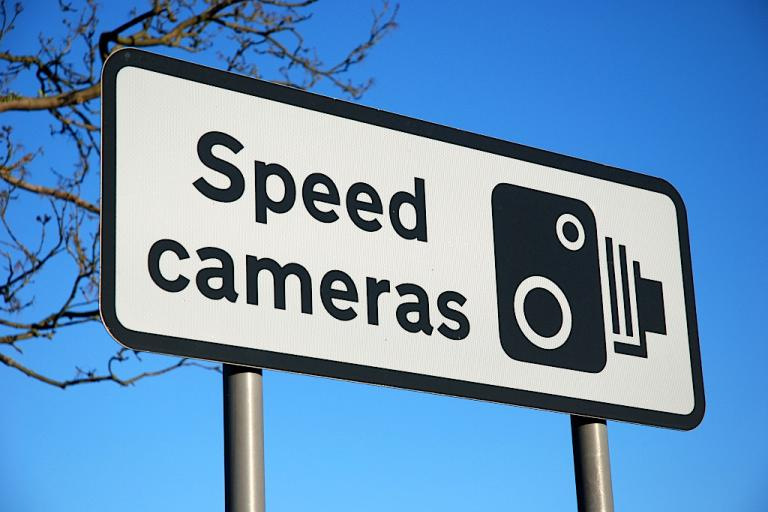 Speed cameras sign (CC BY-NC-SA 2.0 by magic-lantern:Flickr)