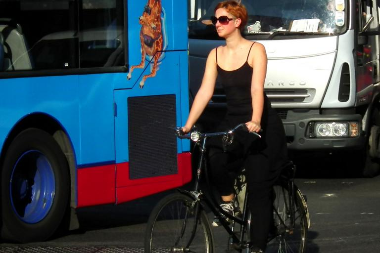 Woman on bike in London (CC licensed image by kenjonbro:Flickr)
