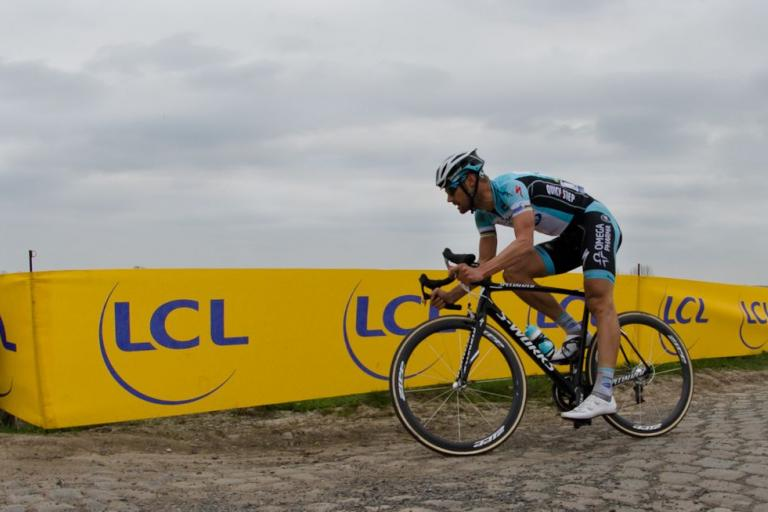 Boonen solos to the finish watched by the worlds media