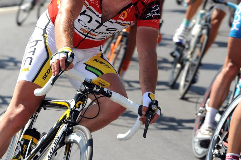 Mark Cavendish in the red leader's jersey in the 2010 Vuelta (copyright- Unipublic:Graham Watson)