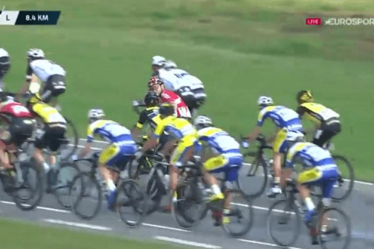 Kris Boeckmans, in the red of Lotto-Soudal, pushes Justin Jules to rear of peloton (Eurosport video still).PNG