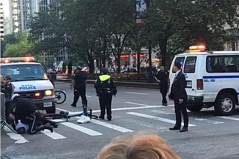 NYPD tackle cyclist as Obama motorcade approaches (source mattpeco Instagram video still).PNG
