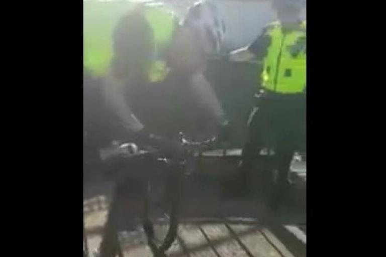 Police officer cycling down steps (via Twitter).jpg