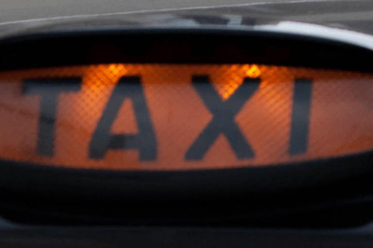 Taxi sign (licensed CC BT 2.0 by Ross Davidson on Flickr, image cropped).PNG