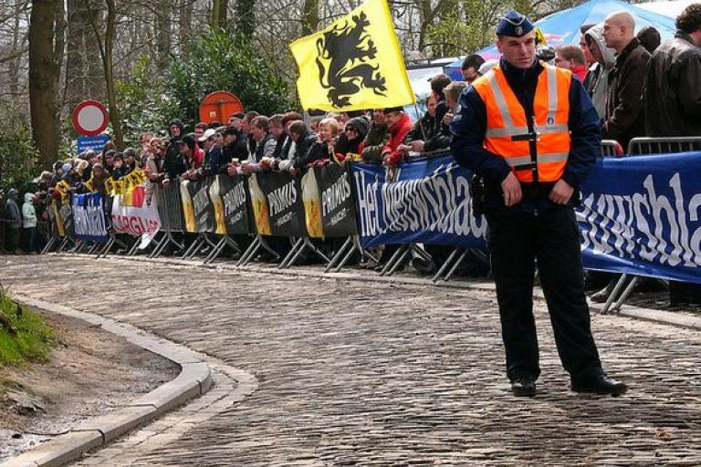 Tour of Flanders policeman (licensed CC BY 2.0 by Louise Ireland on Flickr).JPG