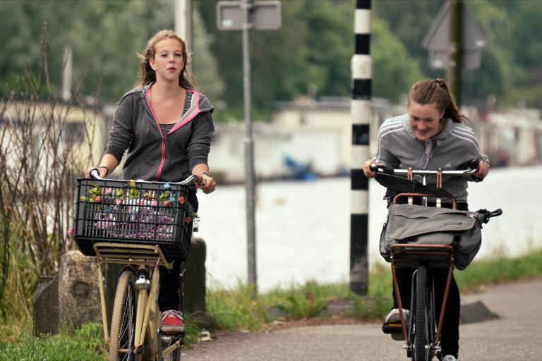Women on bikes (Amsterdamize www.flickr.com:photos:amsterdamize:).jpg