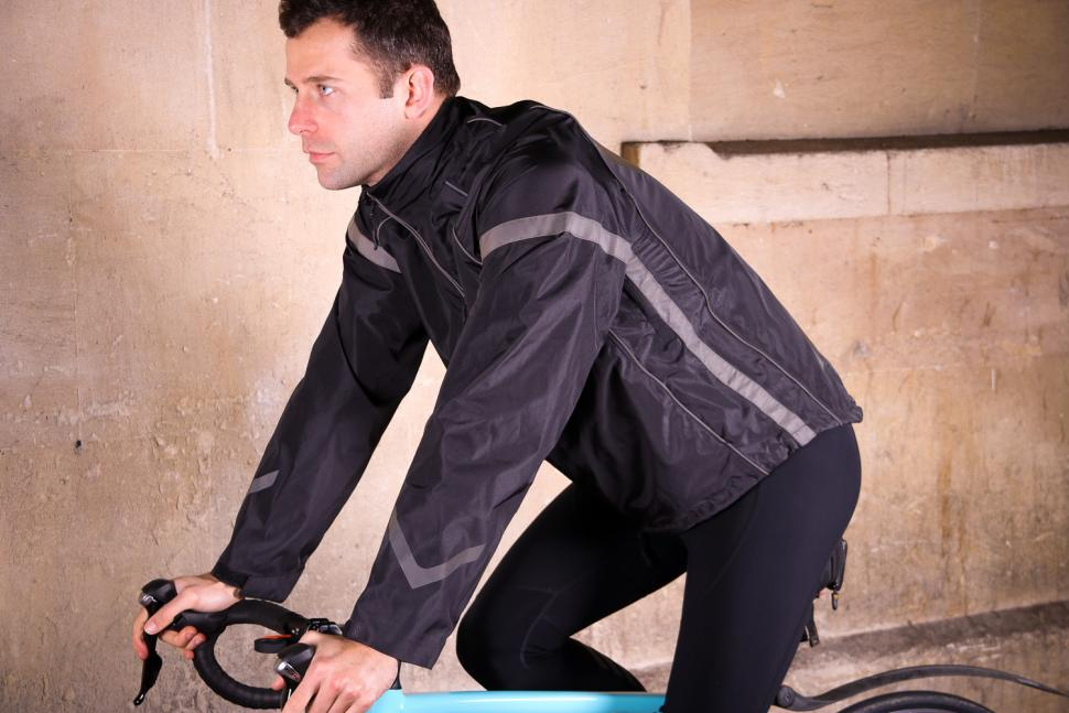 ArroWhere Waterproof Jacket - riding.jpg