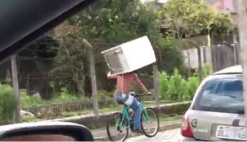 Brazil fridge cyclist (Luam Paim Facebook video still).PNG