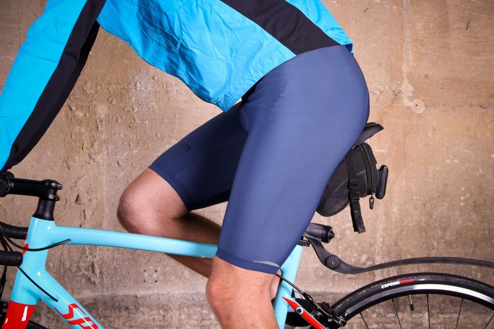 Cafe du Cycliste Adele Cobalt Blue Thermal Bib Shorts - riding.jpg