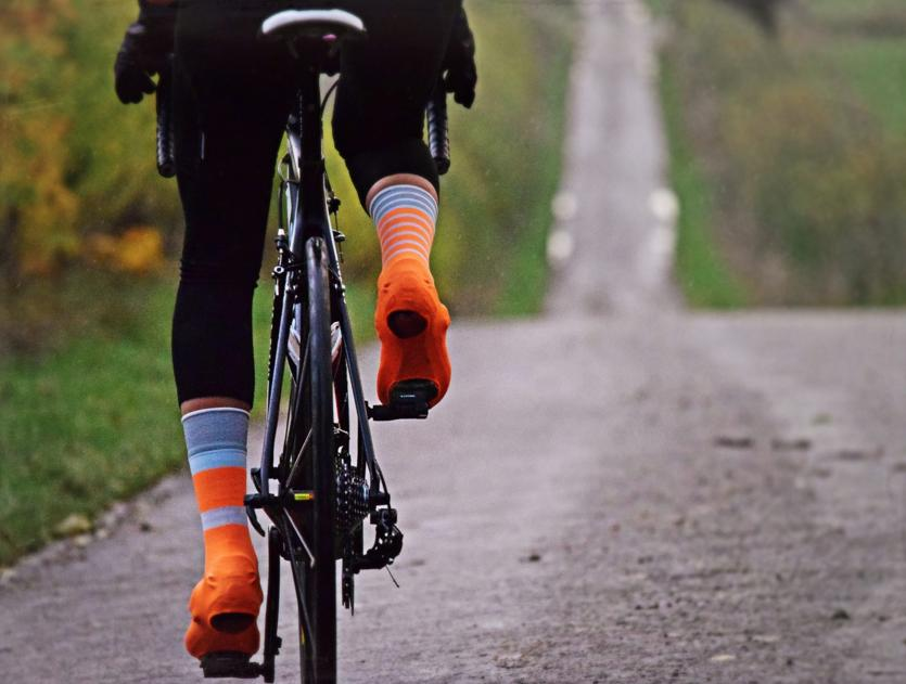 This Is Cambridge Oversocks - Orange Pedalling.png