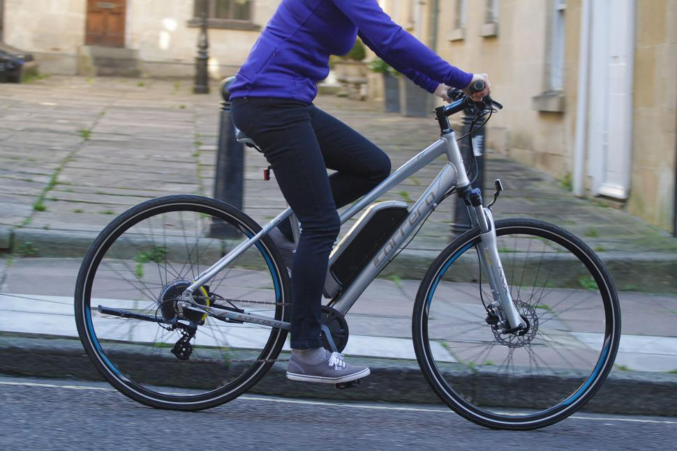 Carrera Crossfire-E Womens Electric Bike - riding 1.jpg