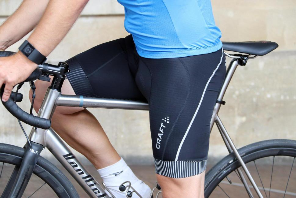 Craft Verve Glow Bib Shorts - on bike.jpg