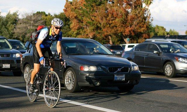 Cyclist and cars - image via Richard Masoner on Flickr.jpg