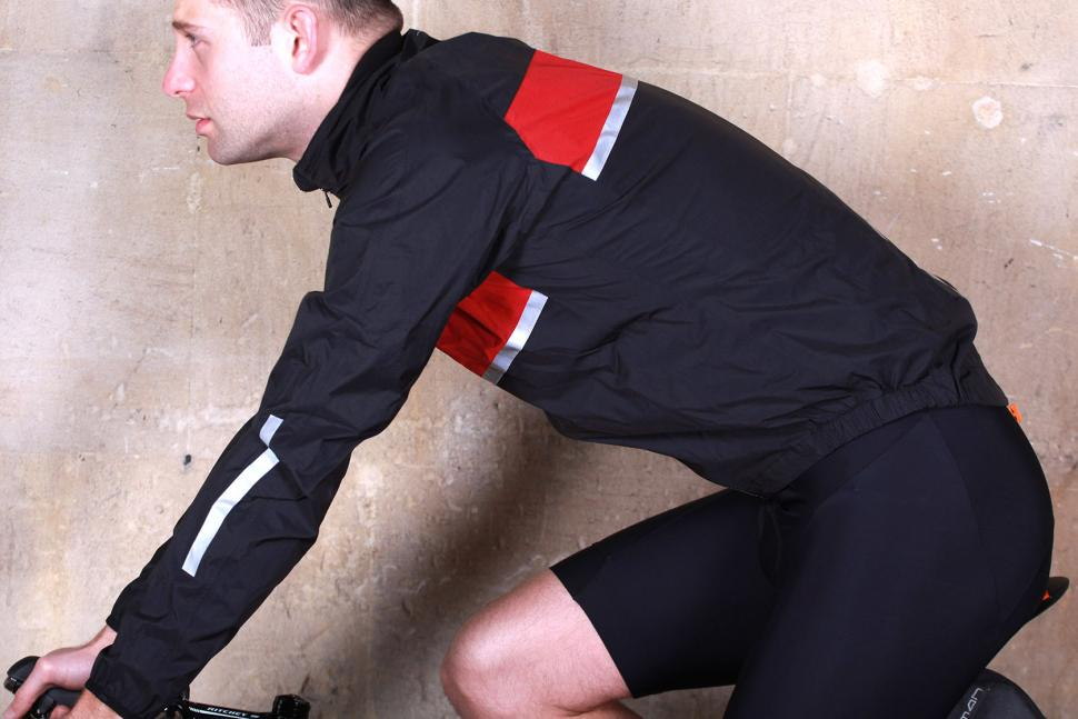 dhb Classic Rain Shell Jacket - riding.jpg